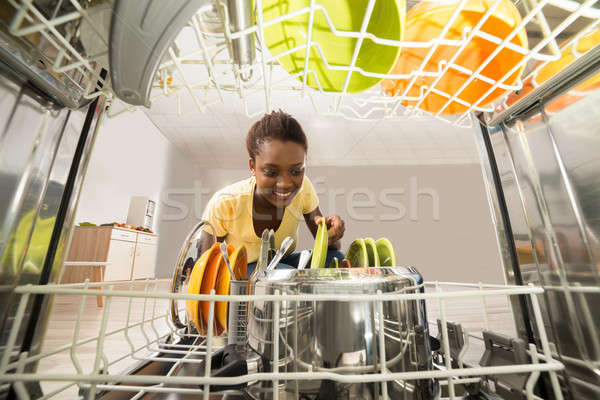 Woman Removing Plate From Dishwasher Stock photo © AndreyPopov