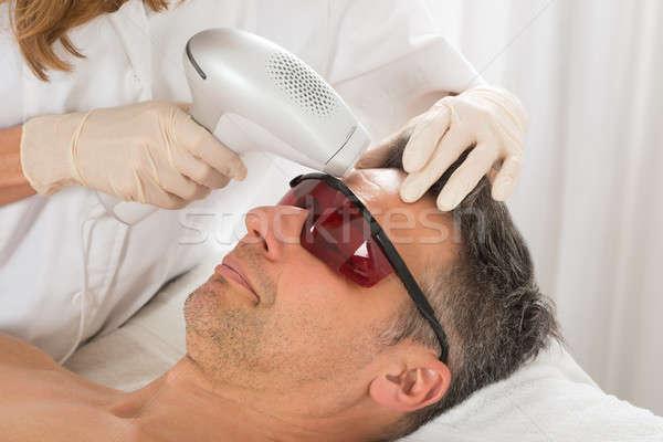 Man Receiving Laser Epilation Treatment Stock photo © AndreyPopov
