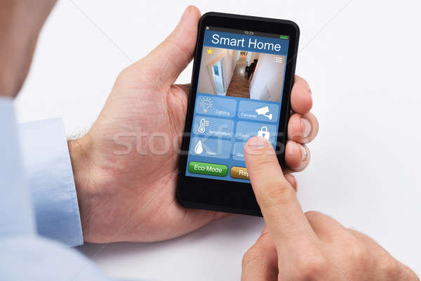 Man Using Home Control System On Laptop Stock photo © AndreyPopov