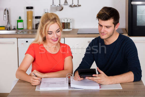 Happy Couple Calculating Invoice In Kitchen Stock photo © AndreyPopov