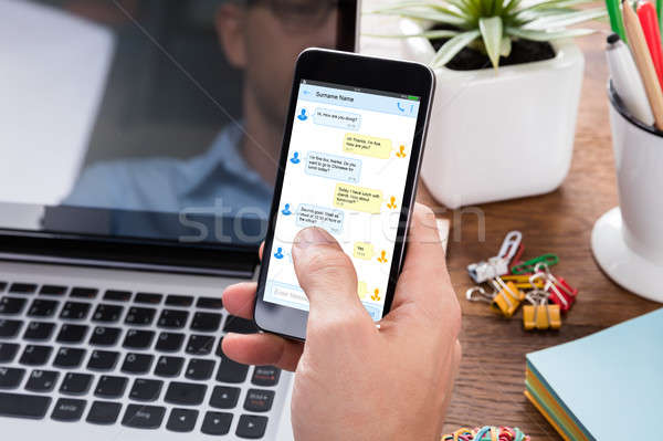 Person Sending Text Message On Mobile Phone Stock photo © AndreyPopov