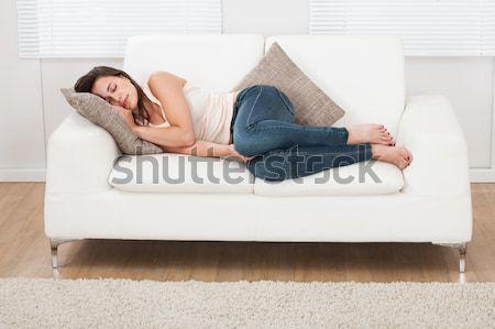 Vrouw slapen sofa jonge vrouw maag Stockfoto © AndreyPopov