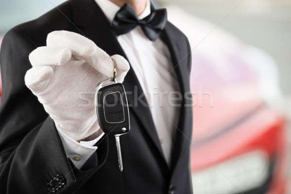 Valet Boy Holding A Car Key Stock photo © AndreyPopov