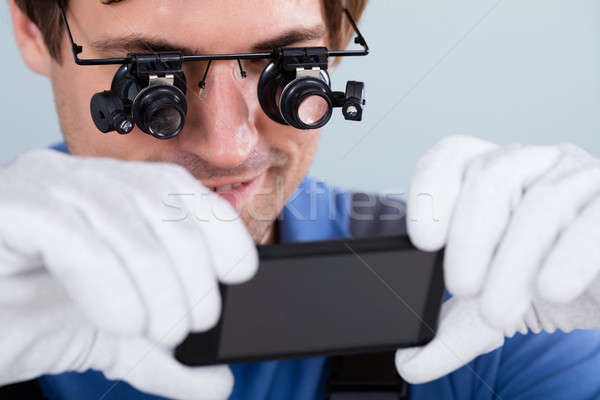 Technician Holding Damaged Mobile Phone Stock photo © AndreyPopov