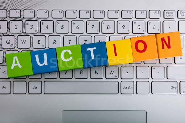 Auction Word On Cubes Over Laptop Stock photo © AndreyPopov