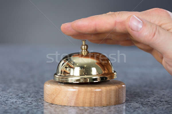 Person Hand Ringing Service Bell Stock photo © AndreyPopov
