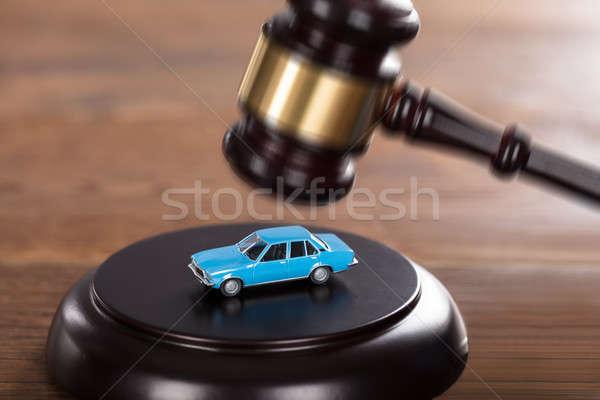 Gavel Striking On A Car Model Stock photo © AndreyPopov