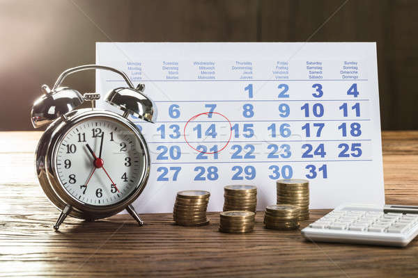 Tax Time On Alarm Clock With Coins Stock photo © AndreyPopov