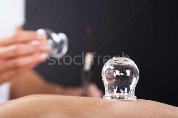 Terapeuta leczenie powrót strony ognia Zdjęcia stock © AndreyPopov