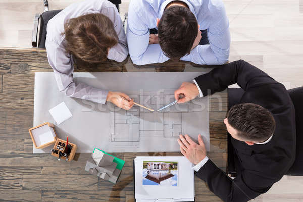 Couple And Architect Working On Blueprint Stock photo © AndreyPopov