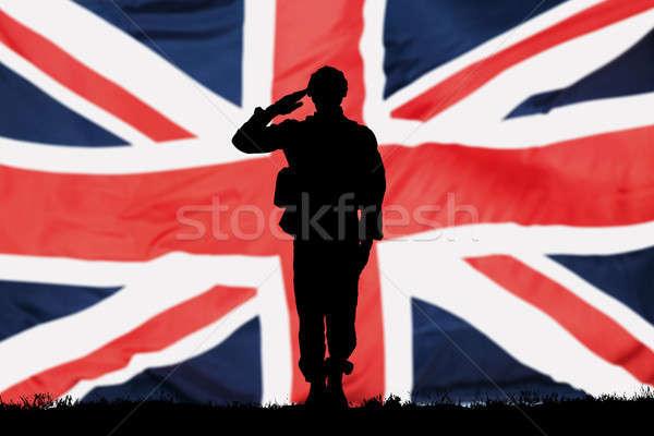 Sziluett brit zászló férfi háttér szolgáltatás katona Stock fotó © AndreyPopov
