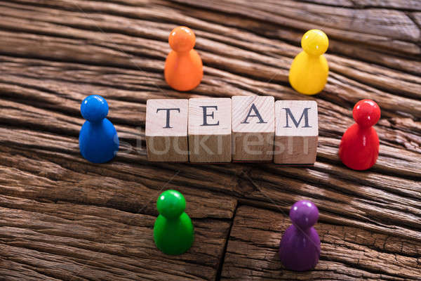Team Word On Wooden Block With Multi Colored Sculpture Stock photo © AndreyPopov