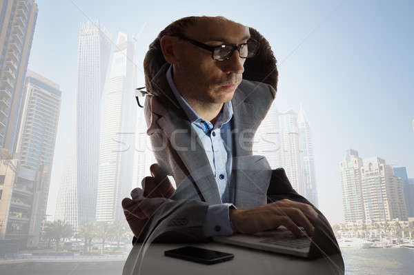 Digital Composite Of Businessman And Buildings Stock photo © AndreyPopov