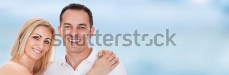 Portrait Of Happy Couple With One Child Stock photo © AndreyPopov