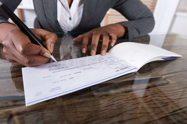 Human Hand Signing Cheque Stock photo © AndreyPopov