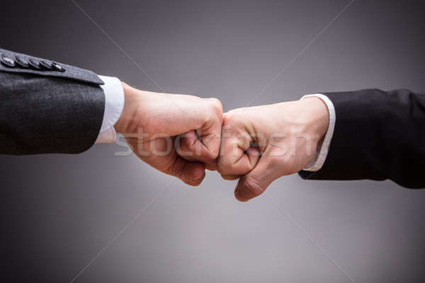 Two Businesspeople Making Fist Bump Stock photo © AndreyPopov
