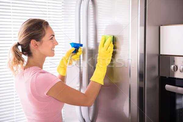 очистки нержавеющий холодильнике счастливым губки Сток-фото © AndreyPopov