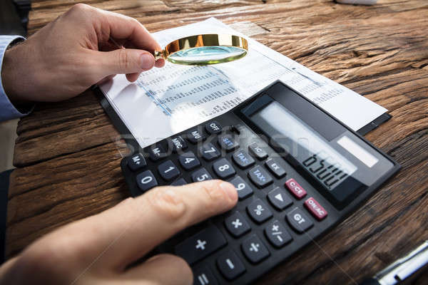 Businessman's Hand Calculating Financial Report Stock photo © AndreyPopov