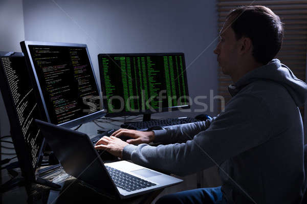 Hacker Stealing Information From Multiple Computers Stock photo © AndreyPopov