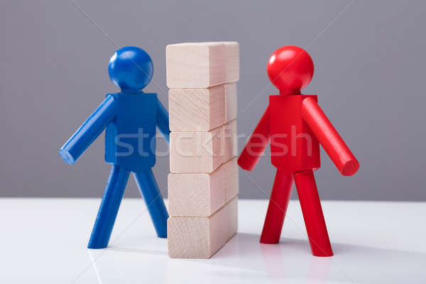 Two Human Figures Separated By Wooden Blocks Stock photo © AndreyPopov