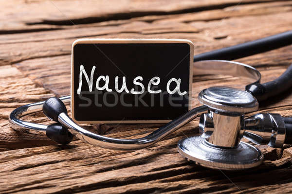 Close-up Of Stethoscope With Slate Showing Nausea Text Stock photo © AndreyPopov