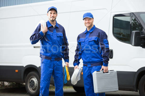 Smiling Repairman With Toolbox And Cable Stock photo © AndreyPopov