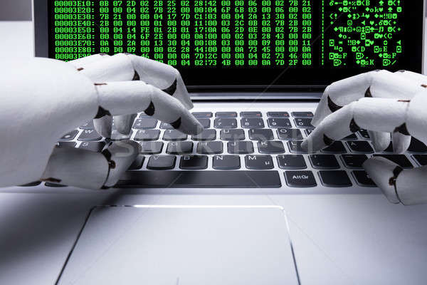 Robot Working On Laptop Stock photo © AndreyPopov