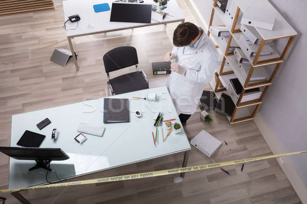 Elevated View Of Forensic Expert Looking For Evidence Stock photo © AndreyPopov