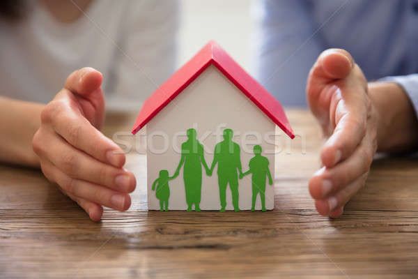 Couple Protecting Family Paper Cut Out And House Model Stock photo © AndreyPopov