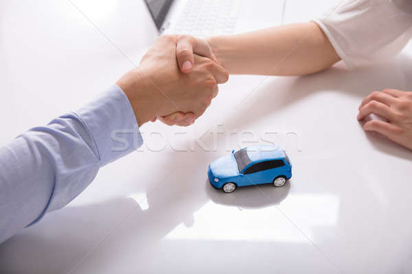 Car Dealer Shaking Hands With His Client Stock photo © AndreyPopov