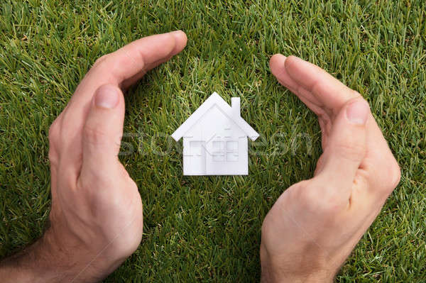 Human Hand Protecting House Model Stock photo © AndreyPopov