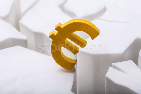 Euros monnaie symbole fissuré blanche surface Photo stock © AndreyPopov