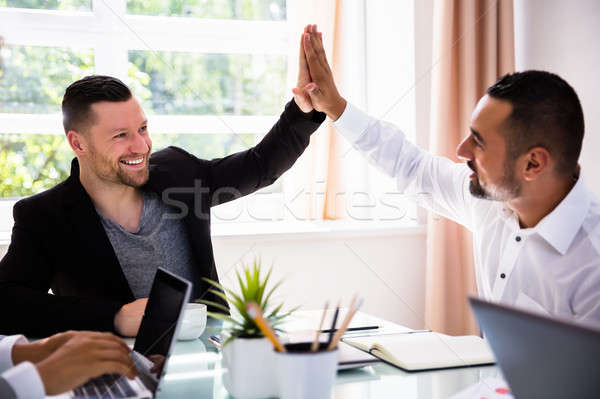 Two Businessmen Giving High Five Stock photo © AndreyPopov