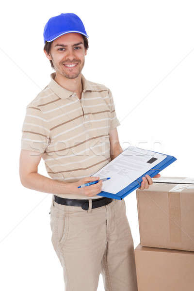 Delivery man asking to sign delivery confirmation Stock photo © AndreyPopov
