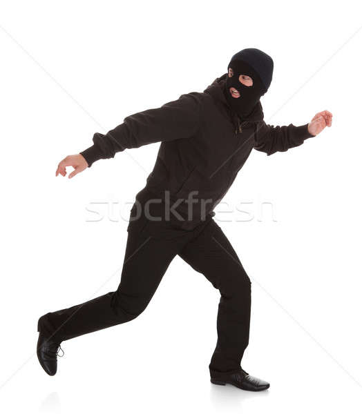 Bandit In Black Mask Running Away Stock photo © AndreyPopov