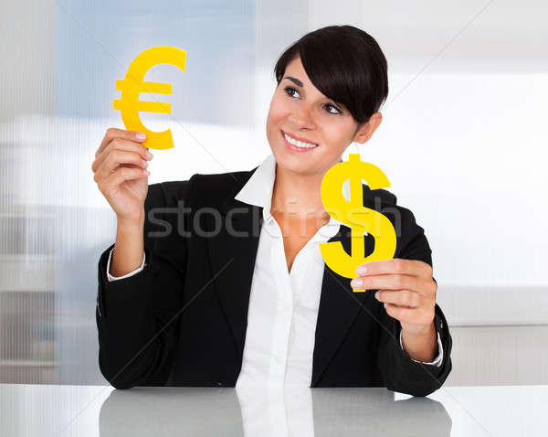 Businesswoman With Euro And Dollar Sign Stock photo © AndreyPopov