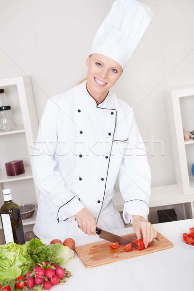 Cheerful woman chef cooking Stock photo © AndreyPopov
