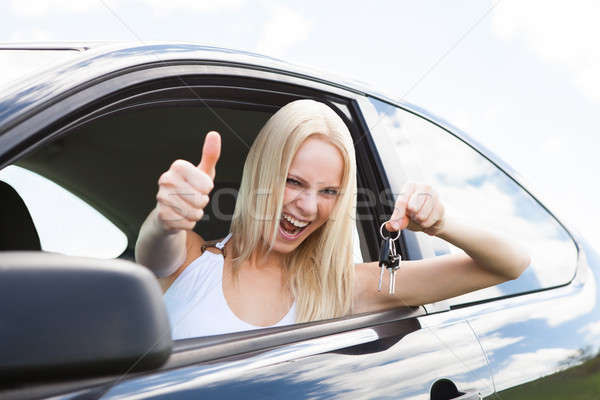 Happy Woman In A Car Showing A Key Stock photo © AndreyPopov