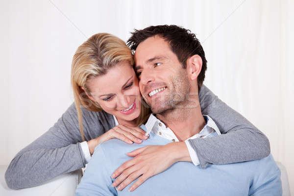 привязчивый пару расслабляющая диван руки вокруг Сток-фото © AndreyPopov