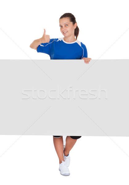 Woman holding blank placard Stock photo © AndreyPopov