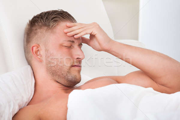 Man waking up with a nasty headache Stock photo © AndreyPopov