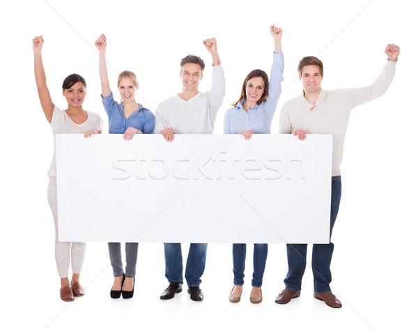 Groep mensen billboard hand witte meisje achtergrond Stockfoto © AndreyPopov