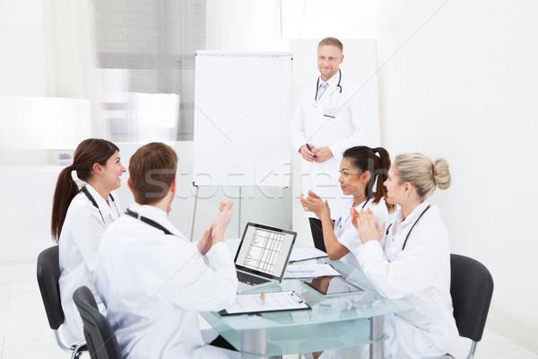 医師 拍手 同僚 プレゼンテーション チーム 小さな ストックフォト © AndreyPopov