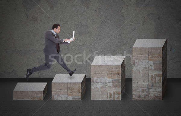 Businessman With Laptop Running On Bar Graph Stock photo © AndreyPopov