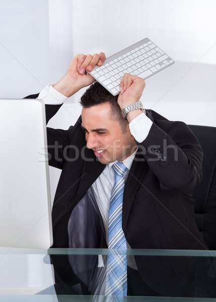 Frustrated Businessman Throwing Computer Keyboard Stock photo © AndreyPopov
