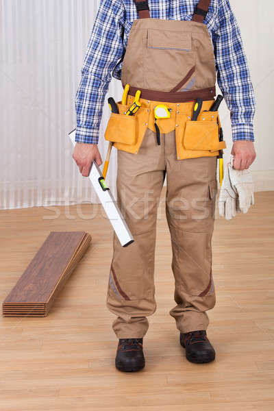 Carpenter With Spirit Level And Gloves Stock photo © AndreyPopov