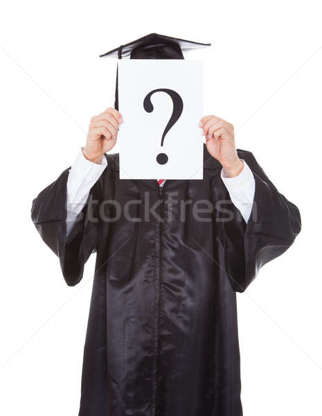 Graduate Person Holding Question Mark Sign Stock photo © AndreyPopov