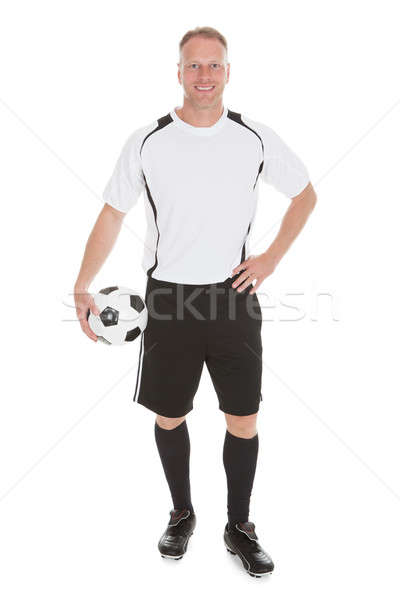 Soccer Player Holding Football Stock photo © AndreyPopov
