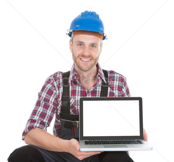 Manual Worker Displaying Laptop Stock photo © AndreyPopov