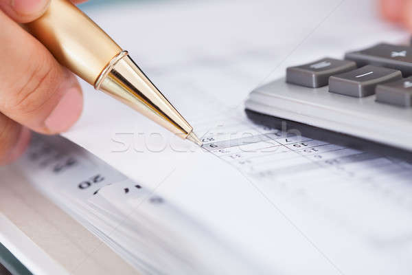 Businessman Checking Expense In Office Stock photo © AndreyPopov